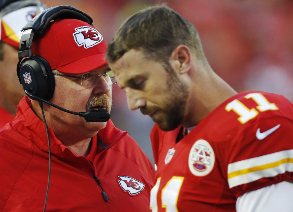 Kansas City Chiefs coach Andy Reid, left, talks with quarterback Alex Smith during the first half of an preseason NFL football game against the San Francisco 49ers at Arrowhead Stadium in Kansas City, Mo., Friday, Aug. 16, 2013. (AP Photo/Ed Zurga)