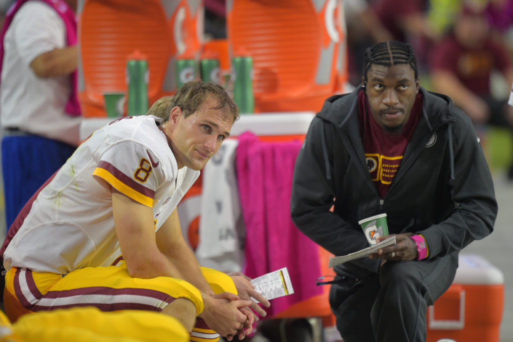 GLENDALE AZ, OCTOBER 12: Washington quarterback Kirk Cousins (8), left, sits with injured quarterback Robert Griffin III (10) on the bench very late in the 4th quarter as the Arizona Cardinals defeat the Washington Redskins 30 - 20 in Glendale AZ, October 12, 2014 (Photo by John McDonnell/The Washington Post via Getty Images)
